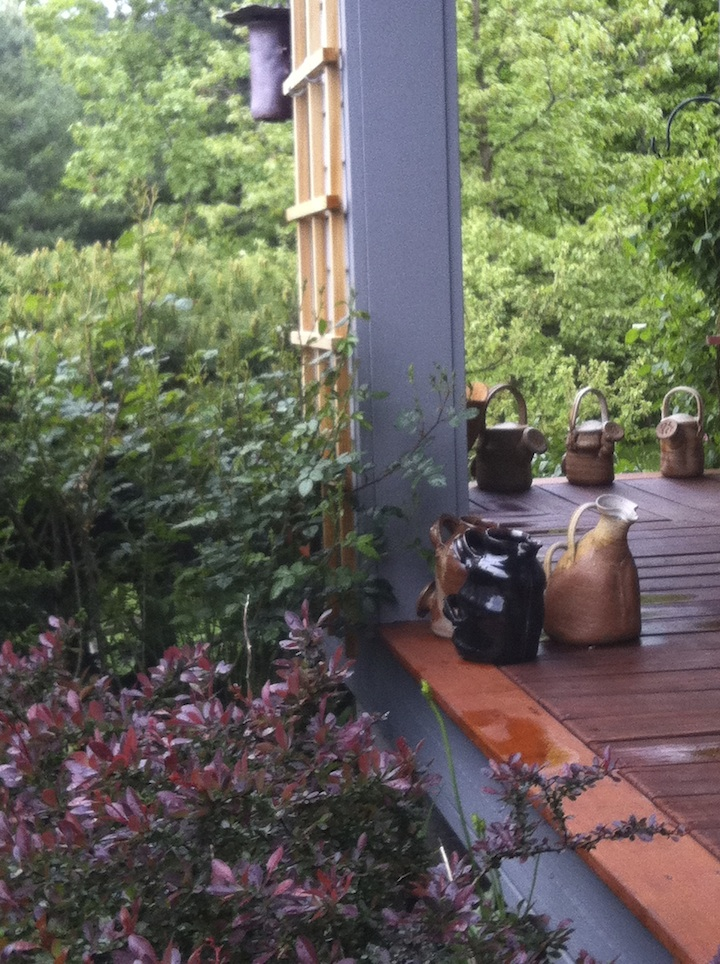 Watering cans on porch